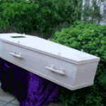Oak veneer coffin with oak handles